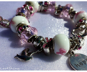 charm bracelet, dove, and pink ribbon image