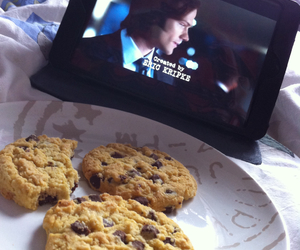 Cookies, in bed, and supernatural image