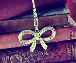 book, bow, and necklace image