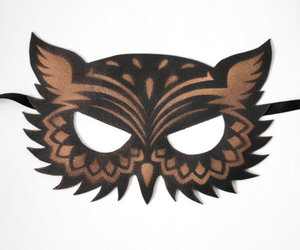 black, gold, and mask image