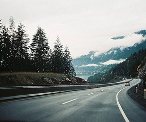 road, mountains, and car image
