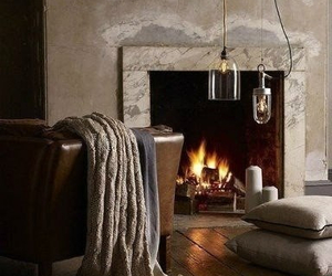 bedspread, fire, and fireplace image
