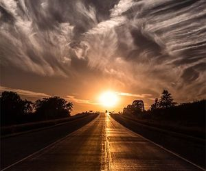 sunset, road, and sky image