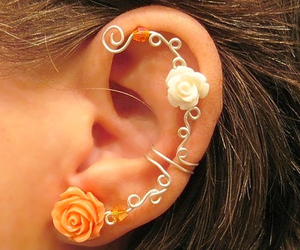 ear, rose, and flowers image