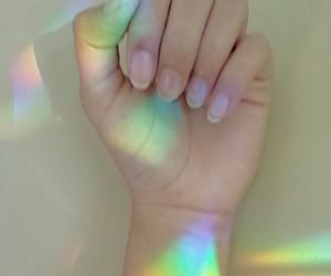 rainbow, hand, and light image