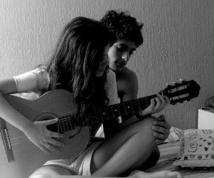 black and white, couple, and guitar image