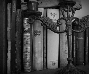 book, candle, and old books image
