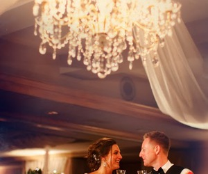 chandelier, couple, and flowers image