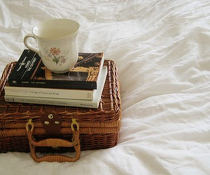 book, bed, and cup image