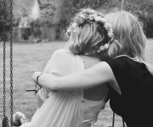 friends, hug, and flowers image