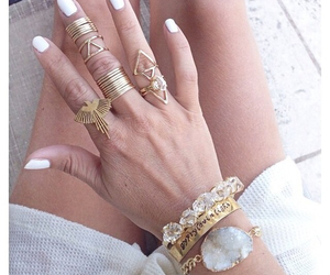 bracelet, nails, and rings image