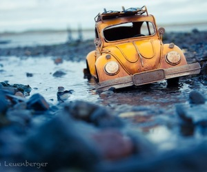 car, water, and yellow image