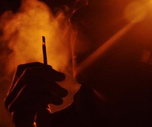 red, smoke, and boy image