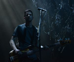 bassist, coldplay, and ghost stories image