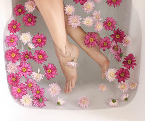 bathtub, feet, and flowers image