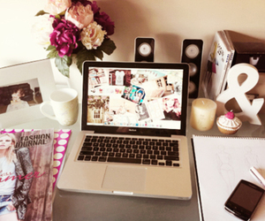 flowers, laptop, and room image