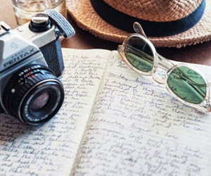 camera, hat, and sunglasses image