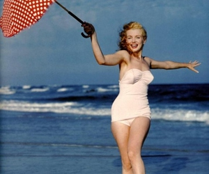 Marilyn Monroe, beach, and umbrella image