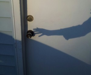 door, hand, and shadow image