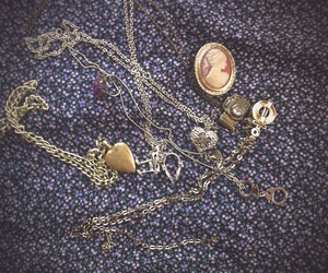 brooch, handcuffs, and vintage image