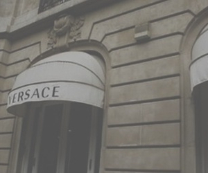 header, brown, and Versace image