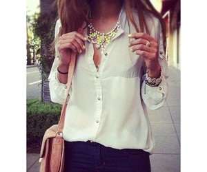 necklace, white shirt, and dark jeans image