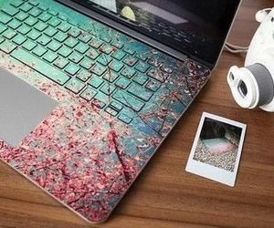 laptop, flowers, and camera image