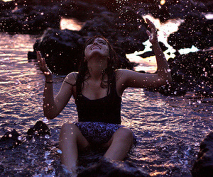 girl, water, and rocks image