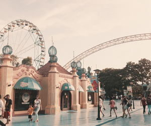 amusement park, ferris wheel, and stores image