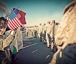 american flag, soldiers, and homecoming image