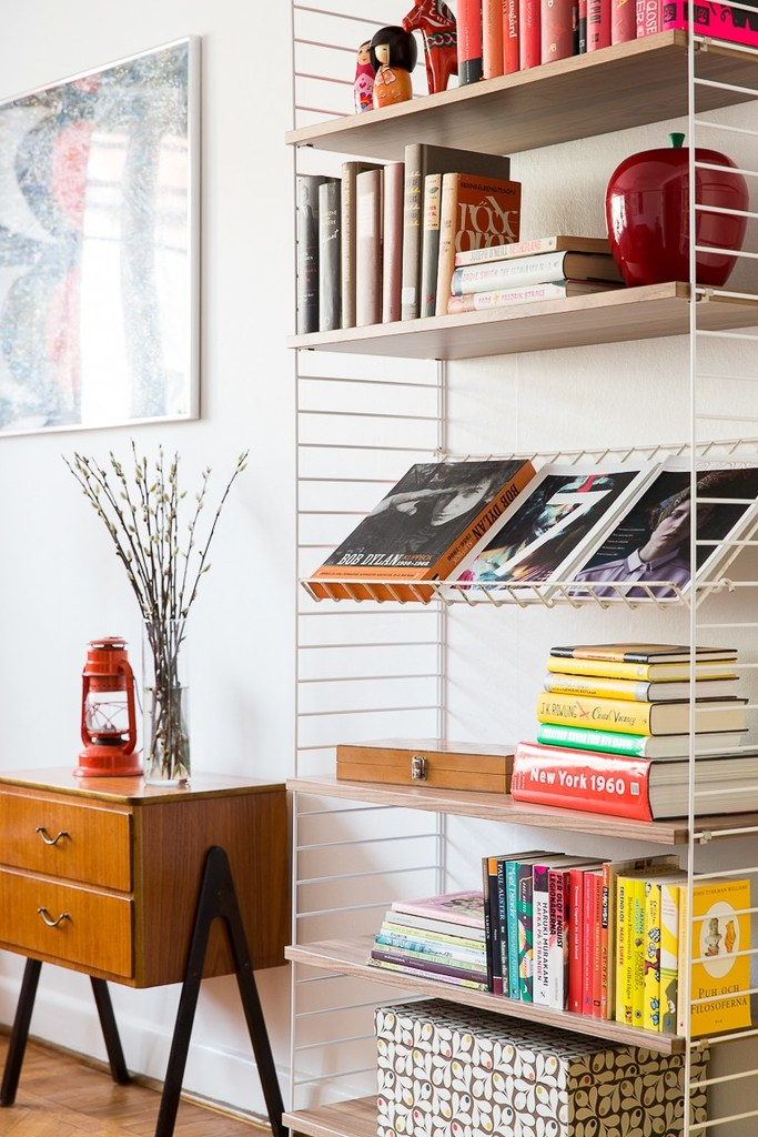 apartment, bookcase, and books image