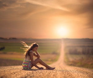girl, sun, and road image