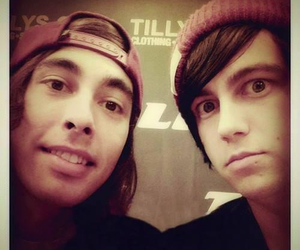 vic fuentes, kellin quinn, and band image