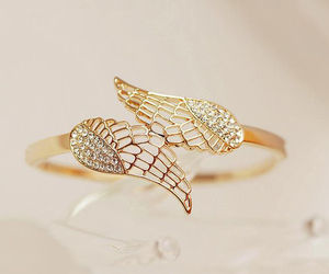 ring, gold, and wings image