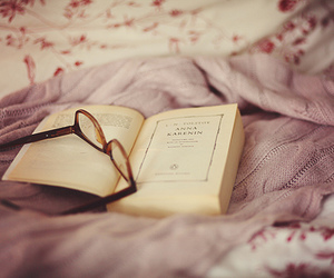 book, bed, and glasses image