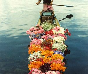 boat, flowers, and sea image