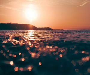 sea, sun, and sunset image