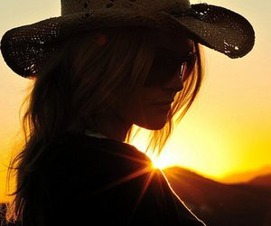 silhouette, sun, and cowgirl hat image