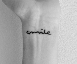 tattoo and smile image