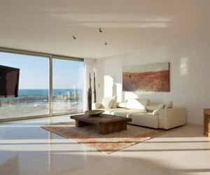 brown color, breezy look, and large glass windows image