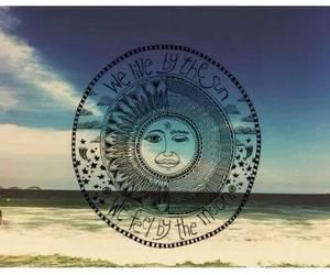 sun, moon, and beach image