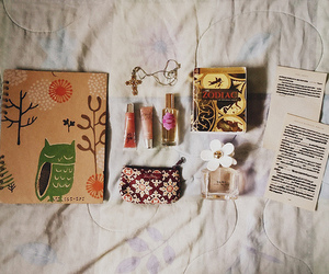 books, floral, and lip gloss image