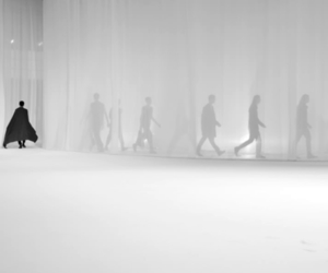 model, runway, and white image