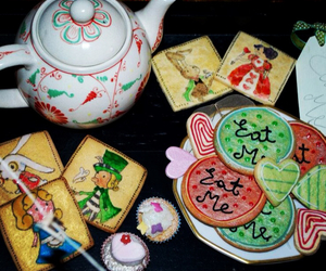 alice in wonderland, eat me, and tea party image