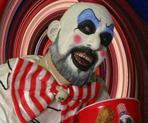 captain Spaulding, rob zombie, and sid haig image