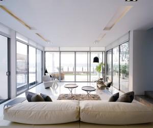 transparent glass window, black circle tables, and villa. image