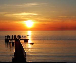 sun, sea, and sunset image