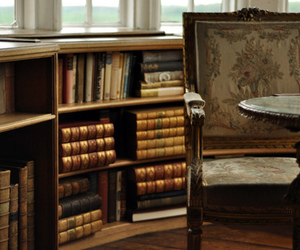 book, antique, and chair image