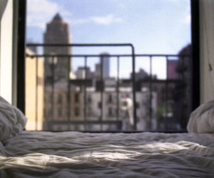 bed, city, and window image