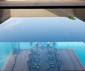 transparent glass windows, luxurious dining space, and natural tone image